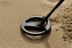 a metal detector on a sand beach